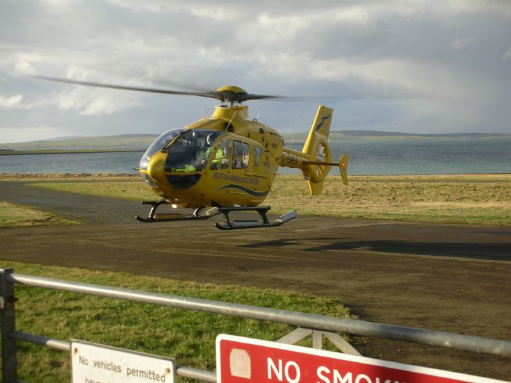 Ambulance helicopter at Stronsay Airfield.