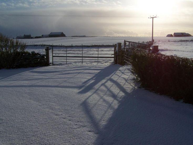 Shadows over a snowy Harray