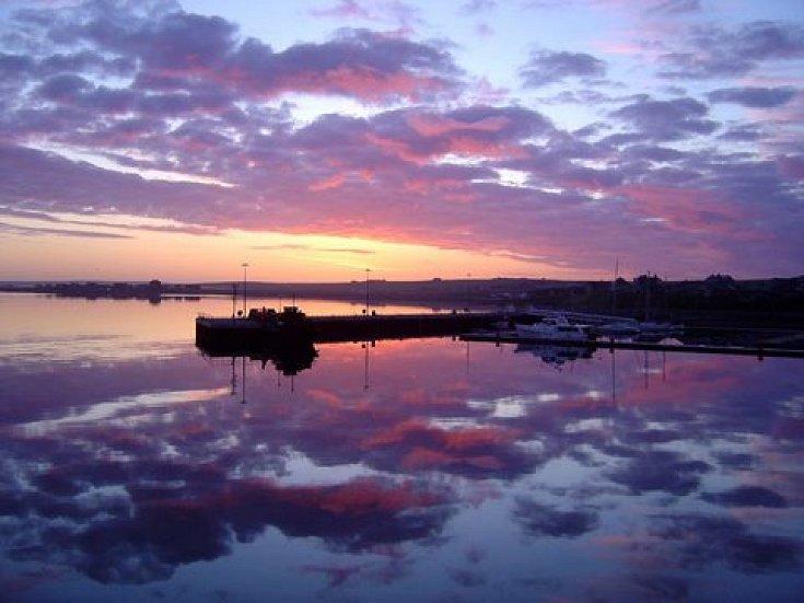 Sunrise over Kirkwall marina