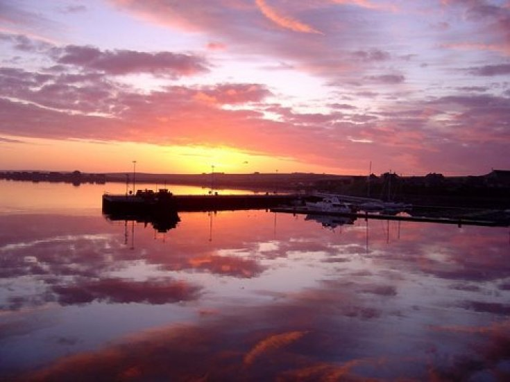 Sunrise over Kirkwall marina