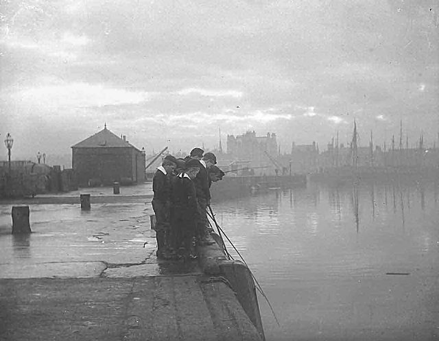 Fishing off the harbour - c1910