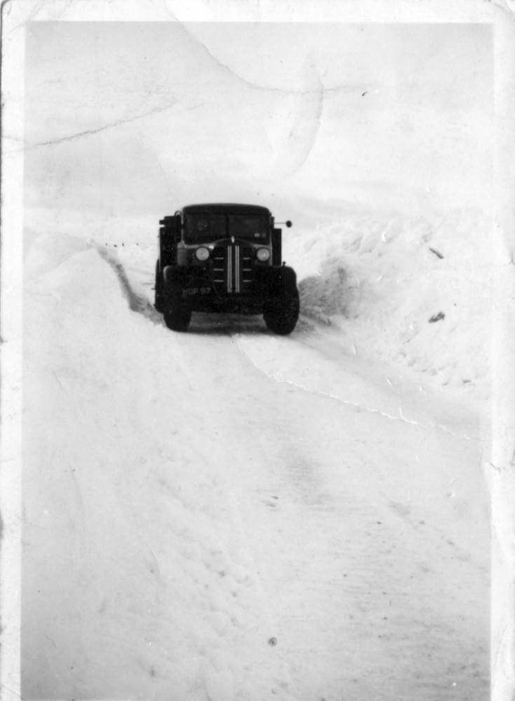 Oil depot truck in heavy snow drifts