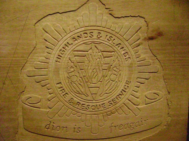 Carved emblem