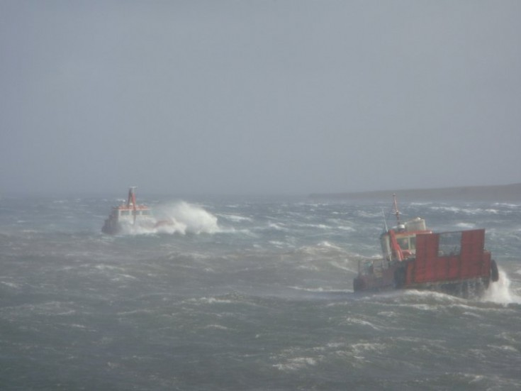Fish farm boats in heavy seas