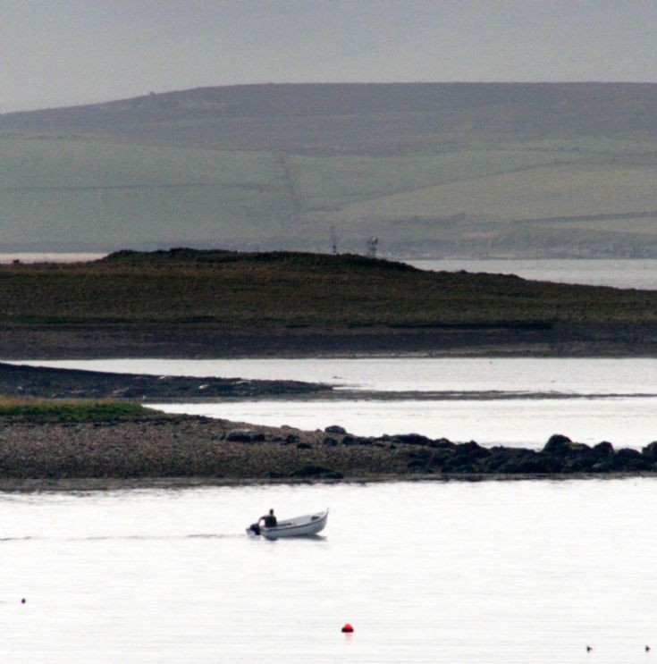 A dinghy by the Holms, by Stromness