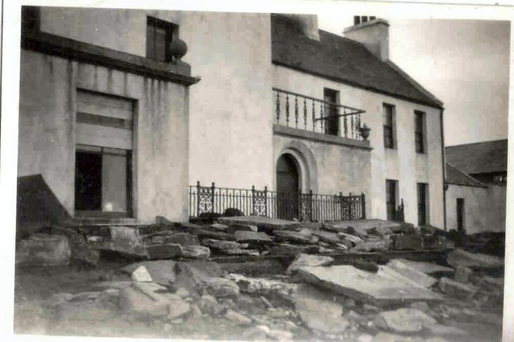 1953 Storm damage in front of the Ayre Hotel.