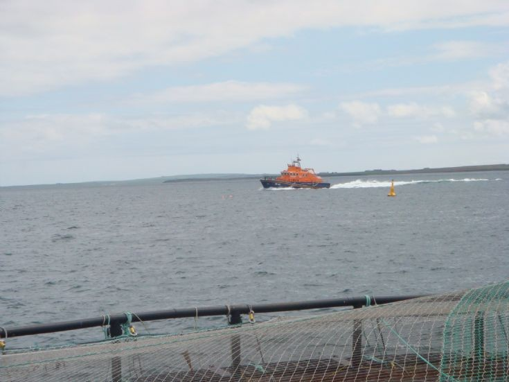 Kirkwall lifeboat going past Puldrite salmon cages