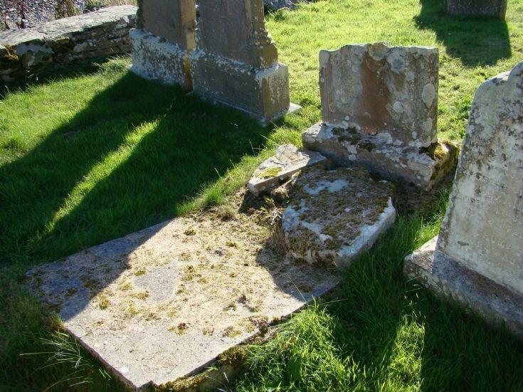 Fallen headstone at kirkyard, Burwick.