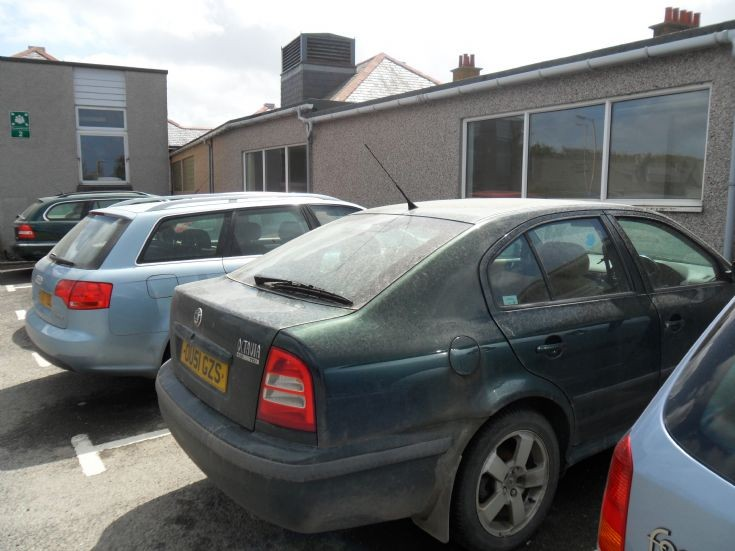 Cars covered in volcanic ash