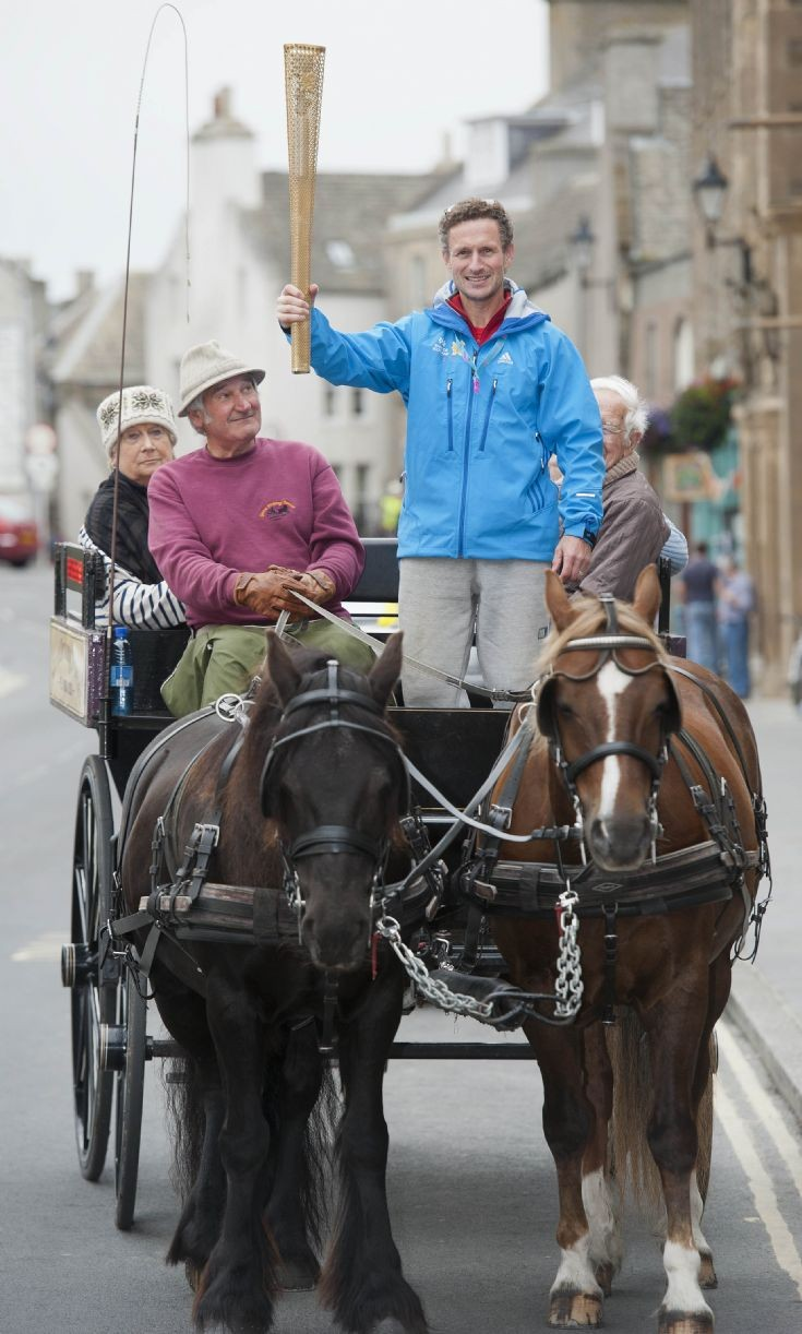 Horse drawn carriage and Olympic torch