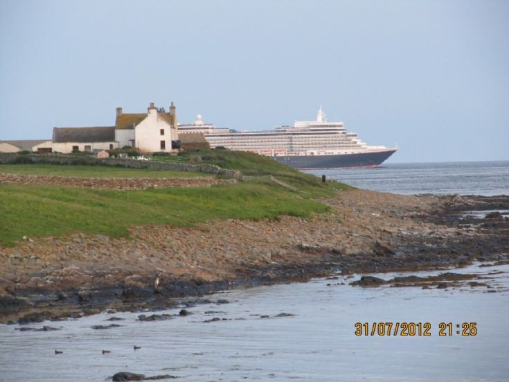 Queen Elizabeth passing Brough in South Ronaldsay