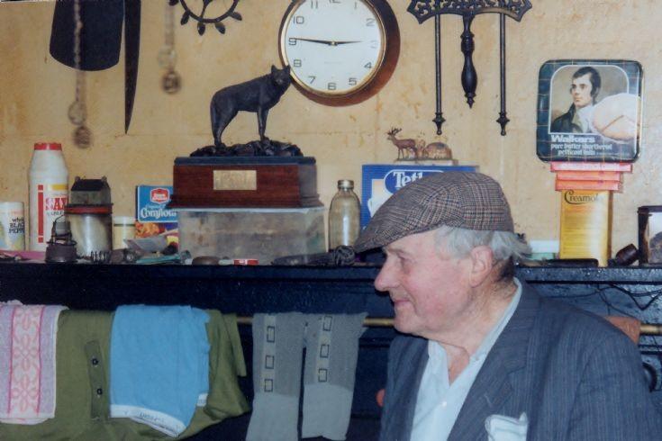 Ned Harrold with Wolf award