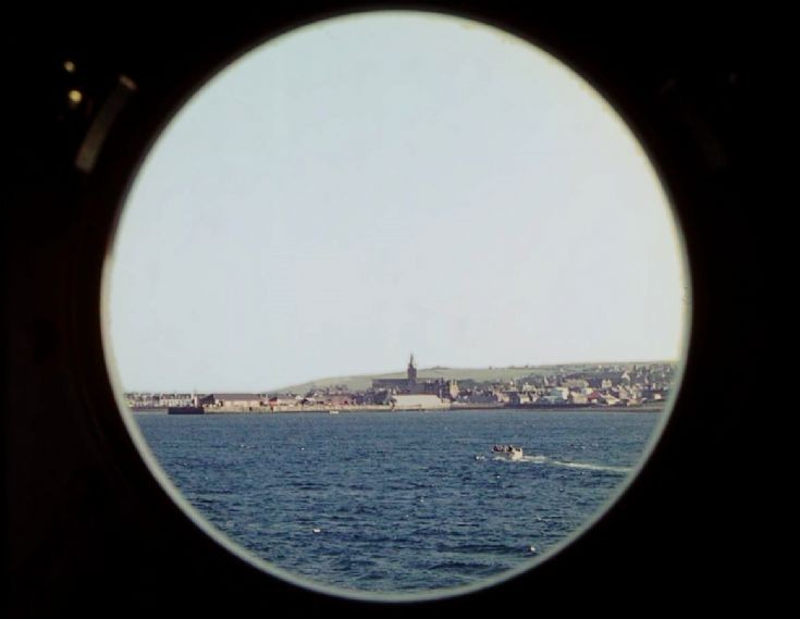 Kirkwall through a porthole of Devonia, June 1966.
