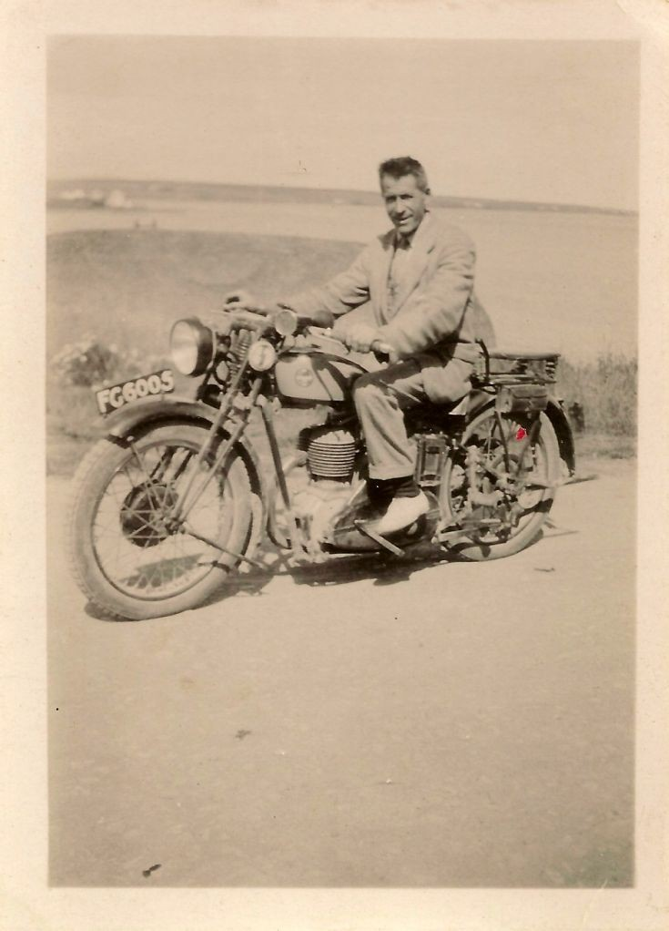 Mystery gentleman on a motorbike