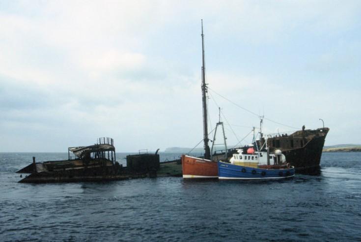 Diving boats alongside Inverlane