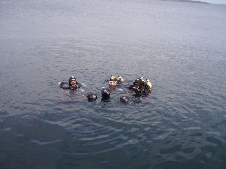 Divers with Scooters in the Flow