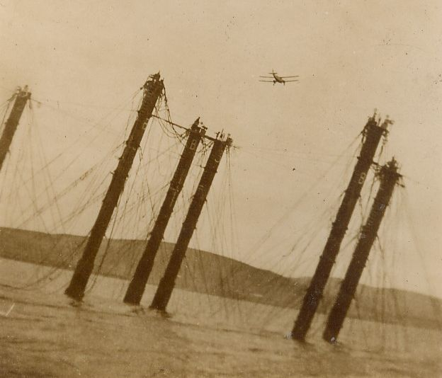 Biplane over German fleet salvage work