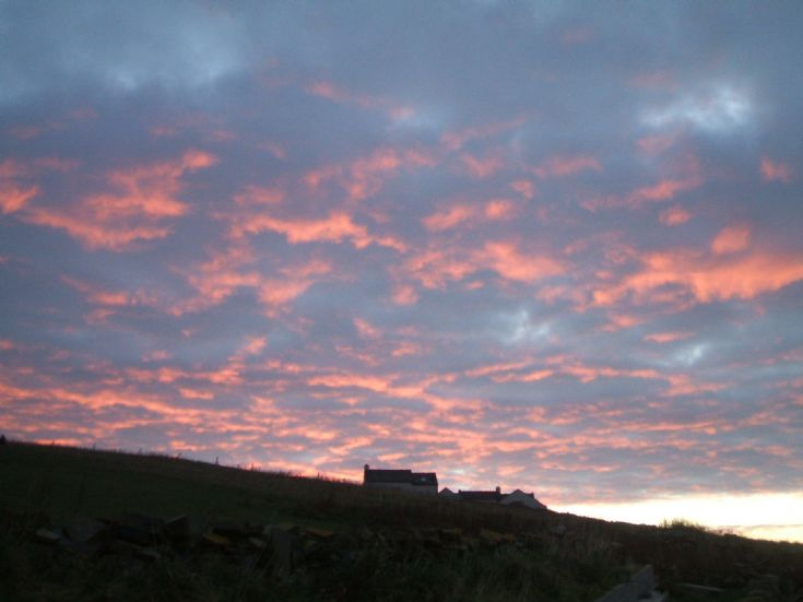 Sunrise over hill in Marwick