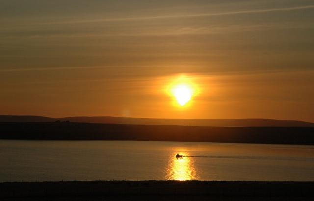 Sun rising over Rousay Sound