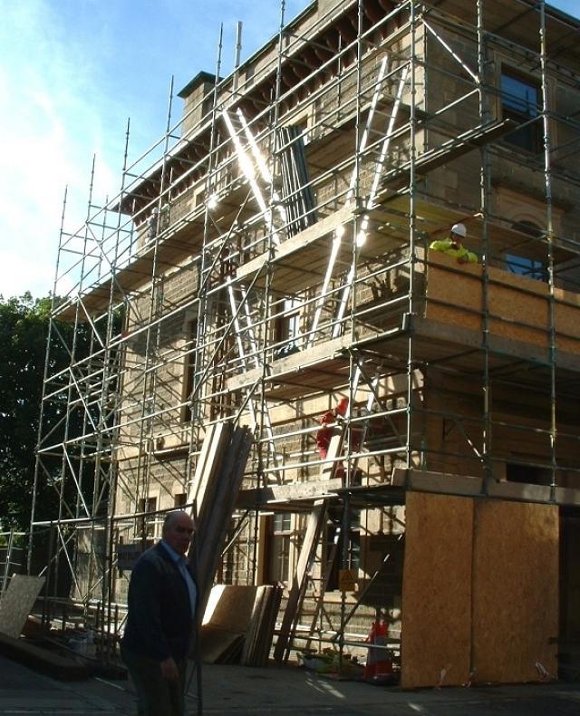 Hydro building scaffolded