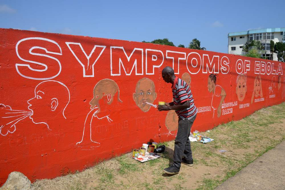 Street artist stephen doe paints an educational mural about ebola in liberia  2014  credit dominique faget  afp  getty  images