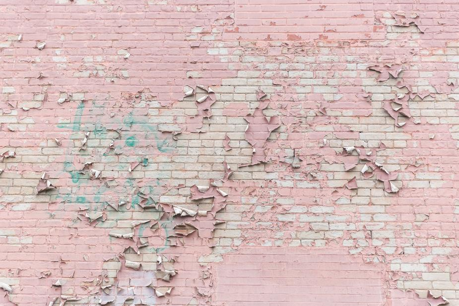 Pink paint peeling off brick wall texture 925x