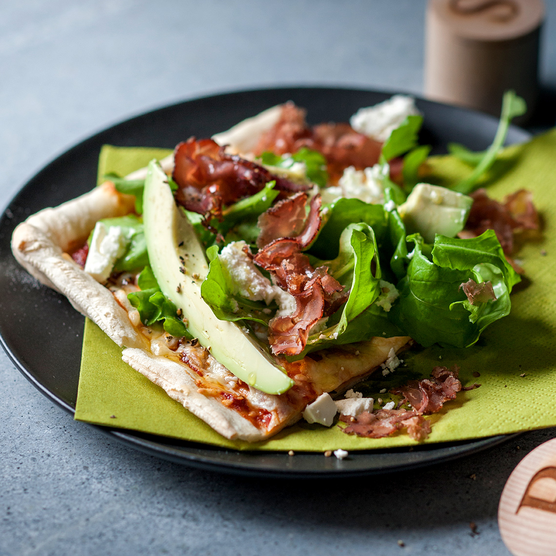 Party pizza with biltong, avocado and feta