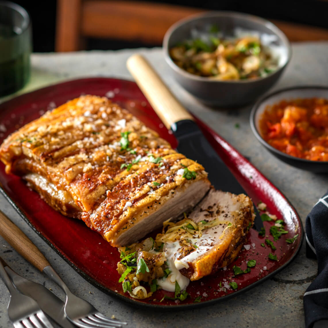 Slow-roasted pork belly with smoky brinjal salad