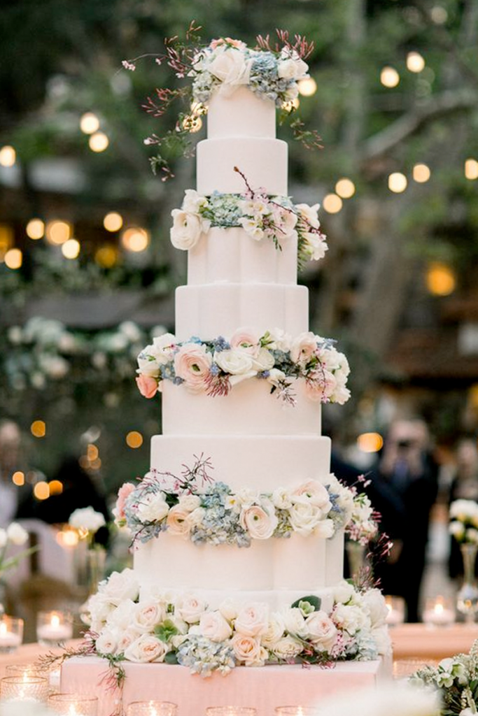 White Tall Wedding Cake with flowers