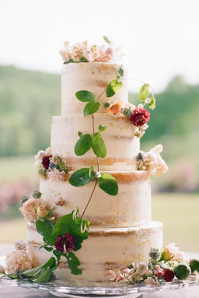 White Elevated Naked Cake with flowers