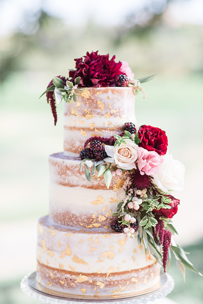 Elevated Naked Cake with red flowers