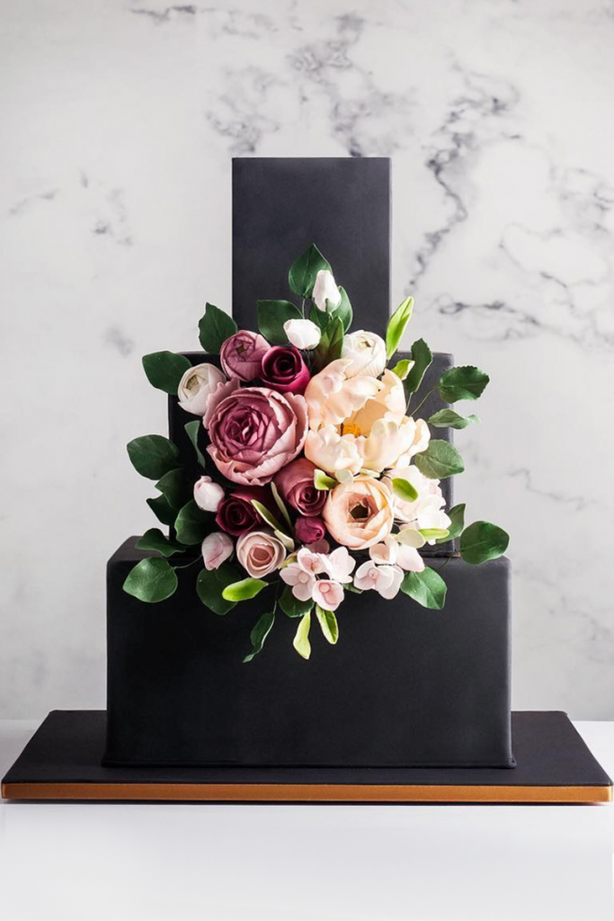 Black Geometric Wedding Cake with Flowers