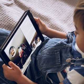 Photograph: Child reading from ipad