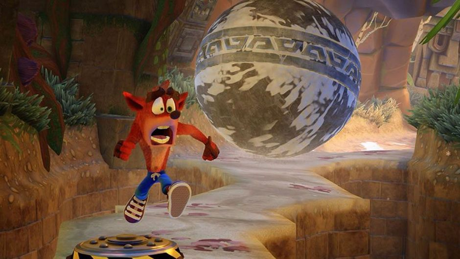 Animated character Crash Bandicoot running from a concrete ball