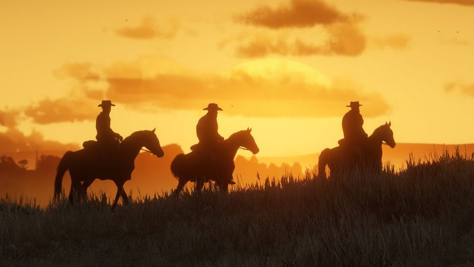 picture showing three cowboys riding horses