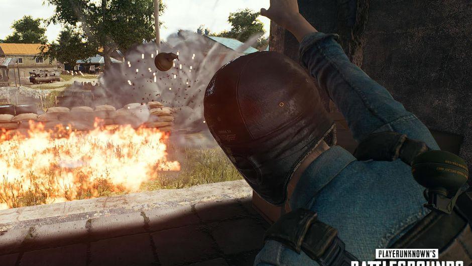 A man in aviator cap throwing grenades in PUBG's mode Dodgebomb