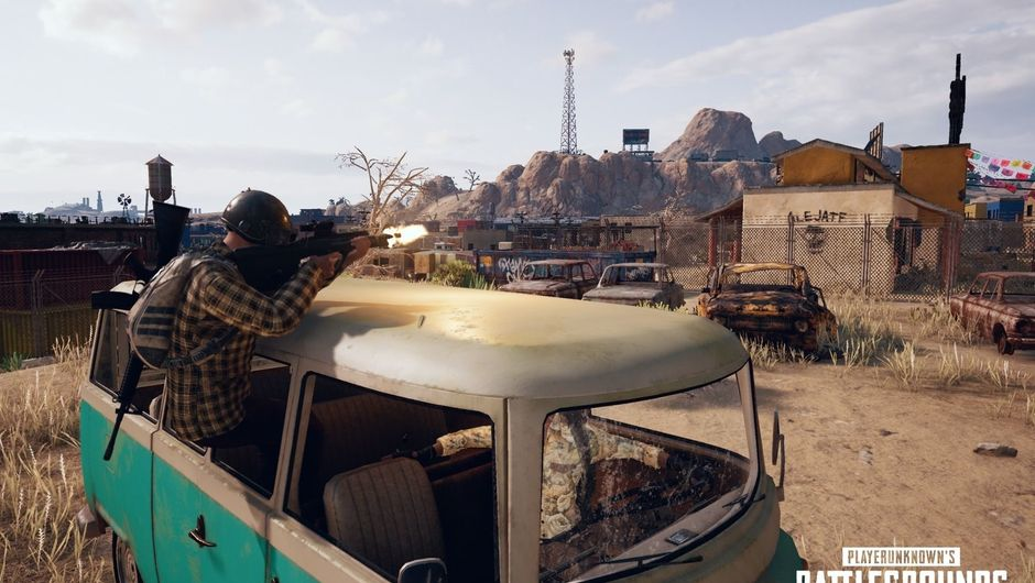 PUBG player shooting a rifle, while taking cover in a VW van