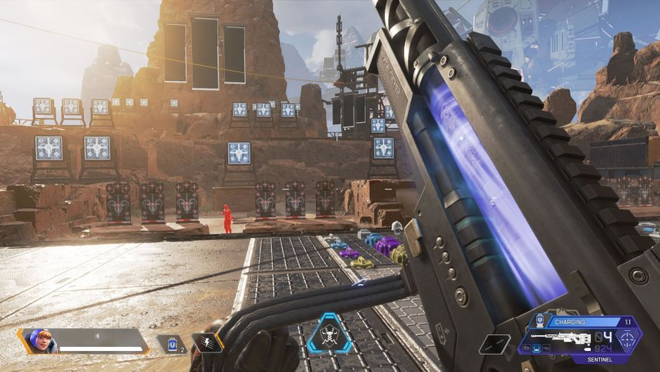 Apex Legends character reloading a gun in first-person