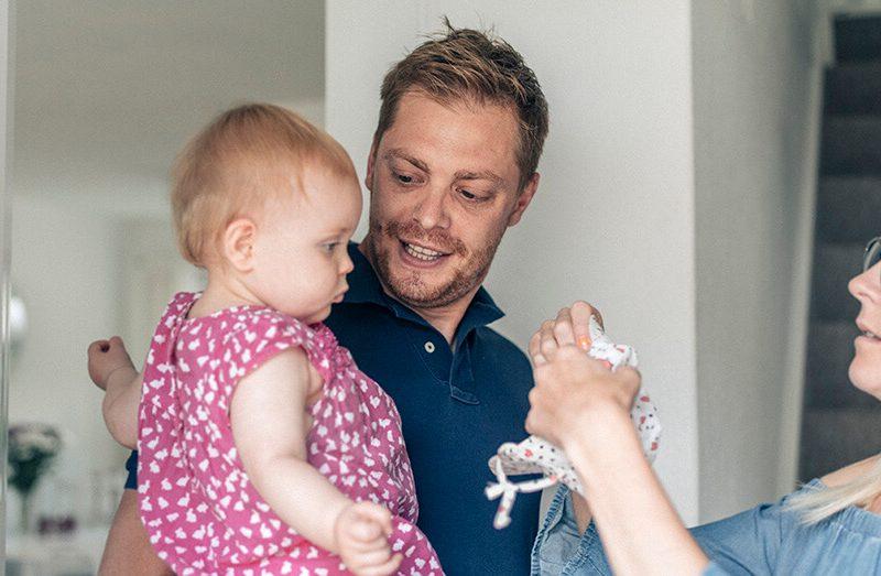 Andrew holding baby