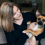 Larrisa holding a dog