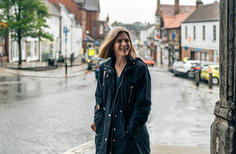 Woman smiling while walking on high street