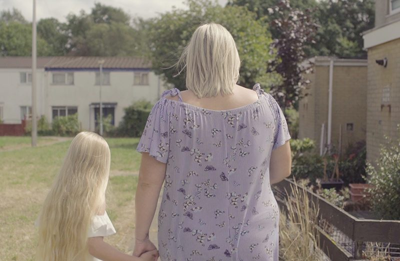 Suzie walking away with daughter