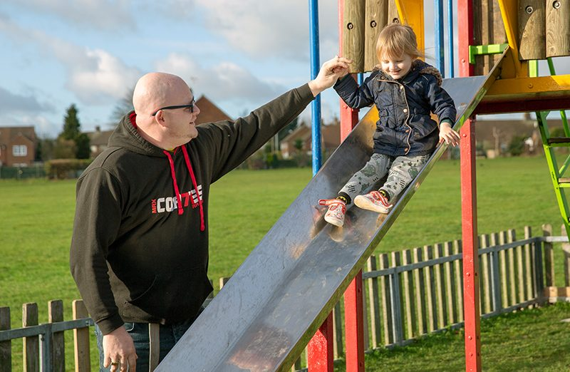 Martin with his daughter on a slide