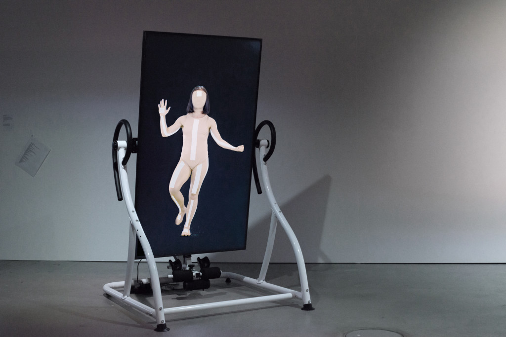 Coralie Vogelaar, 'Infinite Posture Dataset', video installation with a motorised Relax Zone Pro Inversion Table, 2020. Dancer: Courtney May Robertson, Choreography i.c.w Marjolein Vogels. Installation shot at HeK (House of electronic Arts) Basel
