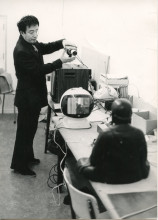 Nam June Paik installing TV-Buddha in the Stedelijk Museum. Photo: Rene Block