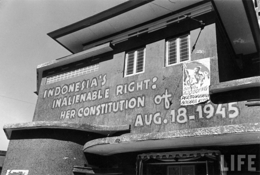 the poster Boeng Ajo Boeng hanging on a building in Jakarta. (Photo: John Florea/LIFE)