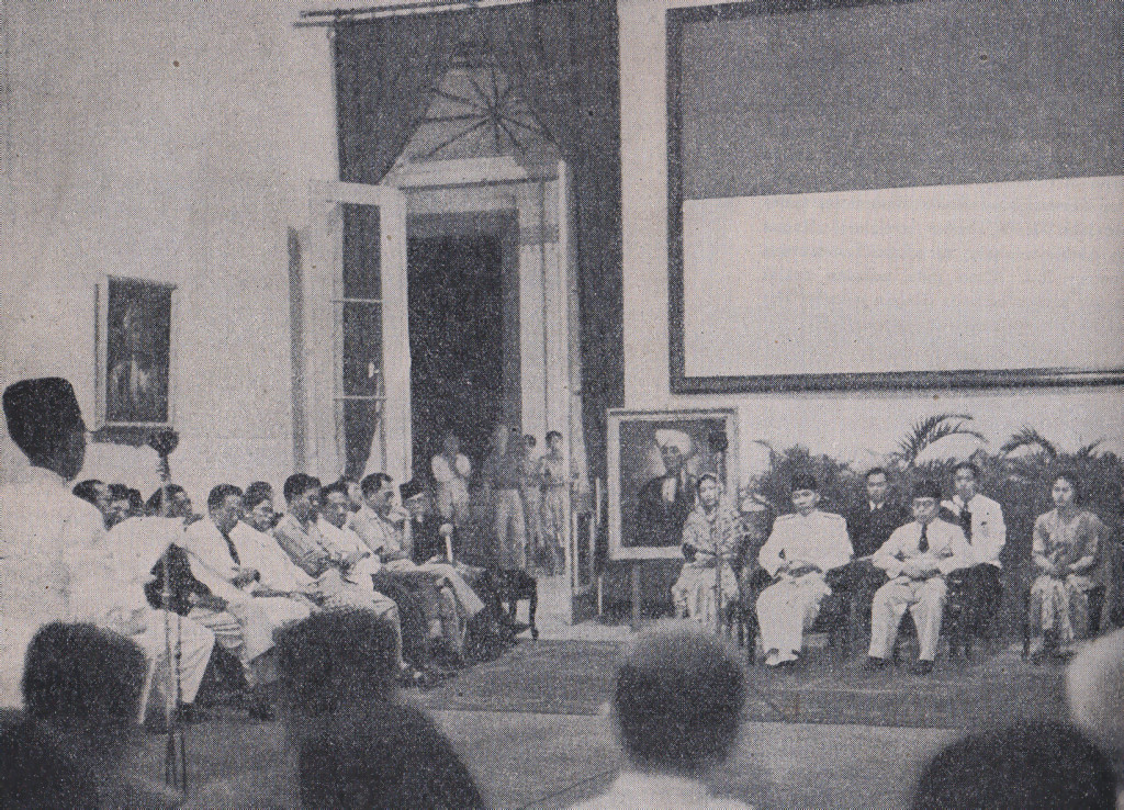 Sukarno and Hatta commemorating Independence Day, 17 August 1947, at the Yogyakarta Presidential Palace. Ki Hajar Dewantara, as the leader of this ceremony, is giving a speech (Photo: Lukisan Revolusi Rakjat Indonesia, 1945–1949).