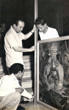 Sukarno, Dullah (crouched), and Gapoer examining a painting at Merdeka Palace, 1950s.