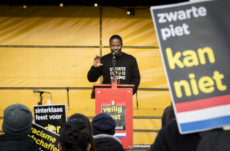 Fig. 5 Anti-Zwarte Piet activist Jerry Afriyie during a demonstration of action group 'Kick Out Zwarte Piet' at the entrance of Ahoy © ANP.