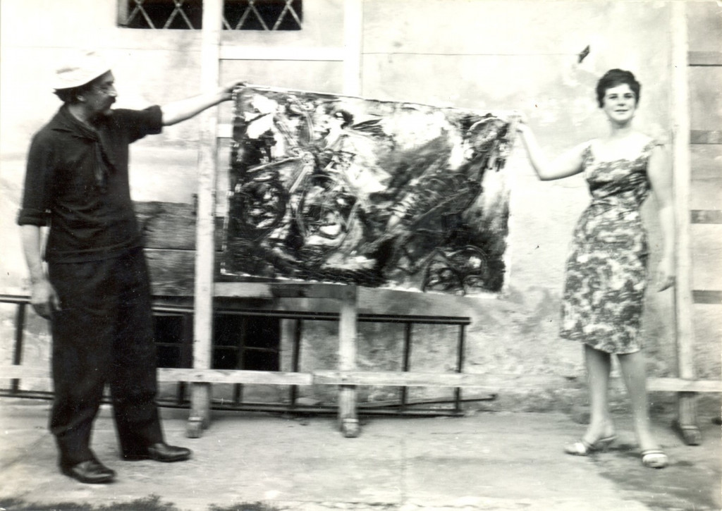 "Giuseppe (Pinot) Gallizio and Jacqueline de Jong with an ""Industrial Painting,"" 1960. Archive Jacqueline de Jong."